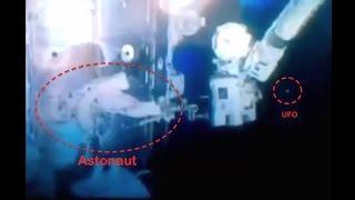 Round UFO Watches Astronaut On Space Walk At Space Station