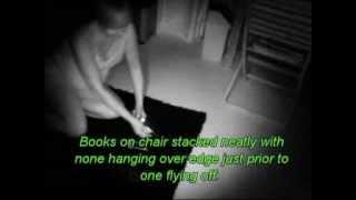 spirit makes book fly off of a chair