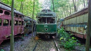 ABANDONED trolley graveyard (over 45 trolleys found in the woods) 4k