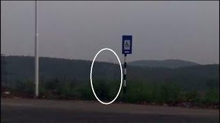 STRANGE GHOST FIGURE CAUGHT NEAR SIGN BOARD Scary Videos