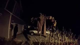 Night time walk thru of Haunted Farm House theme yard