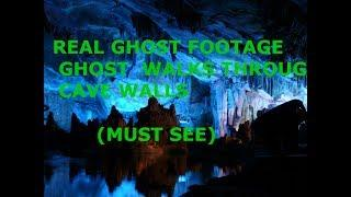 GHOST WALKS THROUGH CAVE WALL IN SLOW MOTION ( MUST SEE )