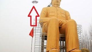 UFO hovering over the golden Chairman Mao Statue in China